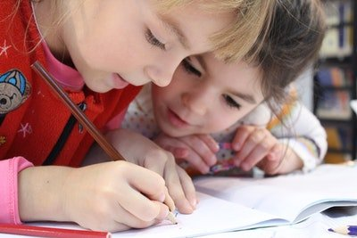 two girls looking at homework