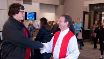 Pastor Keith shaking hands with church member